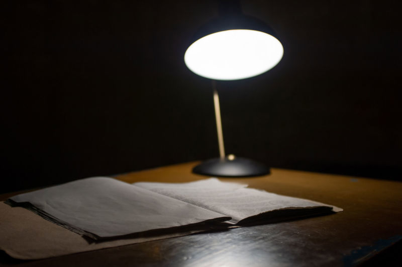 Lamp on desk in a dark room